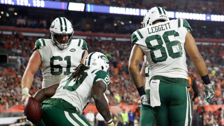 CLEVELAND, OH - SEPTEMBER 20: Isaiah Crowell #20 of the New York Jets celebrates his touchdown with Spencer Long #61 and Jordan Leggett #86 of the New York Jets during the second quarter against the Cleveland Browns at FirstEnergy Stadium on September 20, 2018 in Cleveland, Ohio. Crowell was called for an unsportsmanlike conduct penalty on the play. (Photo by Joe Robbins/Getty Images)