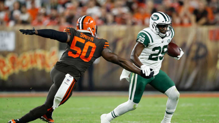 CLEVELAND, OH - SEPTEMBER 20: Bilal Powell #29 of the New York Jets carries the ball in front of Chris Smith #50 of the Cleveland Browns during the second quarter at FirstEnergy Stadium on September 20, 2018 in Cleveland, Ohio. (Photo by Joe Robbins/Getty Images)