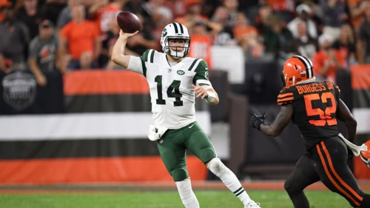 CLEVELAND, OH - SEPTEMBER 20: Sam Darnold #14 of the New York Jets throws a pass in front of James Burgess #52 of the Cleveland Browns during the third quarter at FirstEnergy Stadium on September 20, 2018 in Cleveland, Ohio. (Photo by Jason Miller/Getty Images)
