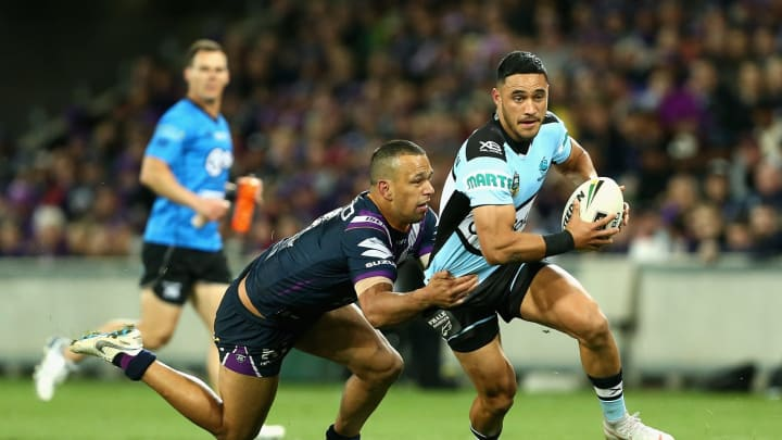 MELBOURNE, AUSTRALIA – SEPTEMBER 21: Valentine Holmesi of the Sharks is tackled during the NRL Preliminary Final match between the Melbourne Storm and the Cronulla Sharks at AAMI Park on September 21, 2018 in Melbourne, Australia. (Photo by Robert Prezioso/Getty Images)
