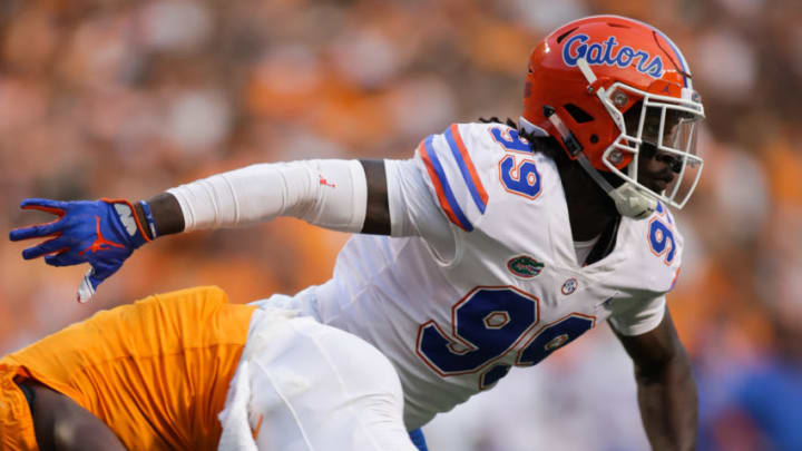 KNOXVILLE, TN - SEPTEMBER 22: Jachai Polite #99 of the Florida Gators gets past Ty Chandler #8 of the Tennessee Volunteers during the first quarter of the game between the Florida Gators and Tennessee Volunteers at Neyland Stadium on September 22, 2018 in Knoxville, Tennessee. (Photo by Donald Page/Getty Images)