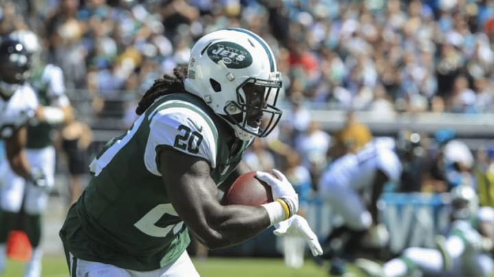 JACKSONVILLE, FL - SEPTEMBER 30: Isaiah Crowell #20 of the New York Jets runs with the ball against the Jacksonville Jaguars during the first half at TIAA Bank Field on September 30, 2018 in Jacksonville, Florida. (Photo by Sam Greenwood/Getty Images)