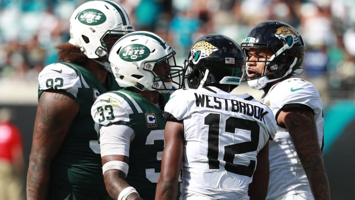 JACKSONVILLE, FL – SEPTEMBER 30: Jamal Adams #33 of the New York Jets and Dede Westbrook #12 of the Jacksonville Jaguars discuss a play during their game at TIAA Bank Field on September 30, 2018 in Jacksonville, Florida. (Photo by Scott Halleran/Getty Images)