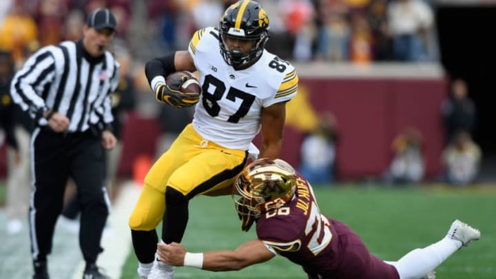 MINNEAPOLIS, MN - OCTOBER 06: Julian Huff #20 of the Minnesota Golden Gophers pushes Noah Fant #87 of the Iowa Hawkeyes out of bounds during the second quarter of the game on October 6, 2018 at TCF Bank Stadium in Minneapolis, Minnesota. (Photo by Hannah Foslien/Getty Images)