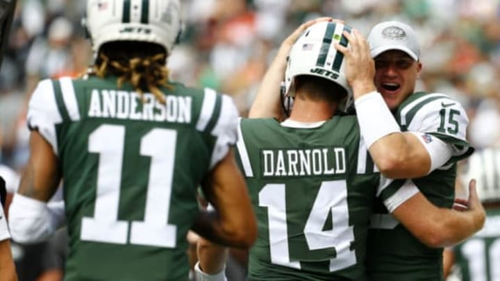 EAST RUTHERFORD, NEW JERSEY – OCTOBER 07: Robby Anderson #11 and Sam Darnold #14 of the New York Jets celebrate with teammate Josh McCown #15 after scoring a 35 yard touchdown against the Denver Broncos during the second quarter in the game at MetLife Stadium on October 07, 2018 in East Rutherford, New Jersey. (Photo by Mike Stobe/Getty Images)