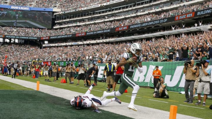 EAST RUTHERFORD, NEW JERSEY - OCTOBER 07: Robby Anderson #11 of the New York Jets scores a 35 yard touchdown against Bradley Roby #29 of the Denver Broncos during the second quarter in the game at MetLife Stadium on October 07, 2018 in East Rutherford, New Jersey. (Photo by Mike Stobe/Getty Images)