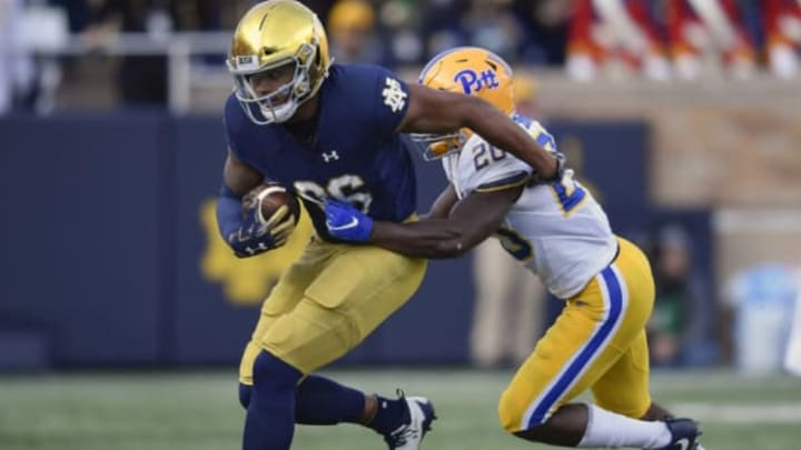 SOUTH BEND, IN – OCTOBER 13: Alize Mack #86 of the Notre Dame Fighting Irish is ran out of bounds by Dennis Briggs #20 of the Pittsburgh Panthers in the second half at Notre Dame Stadium on October 13, 2018 in South Bend, Indiana. (Photo by Quinn Harris/Getty Images)