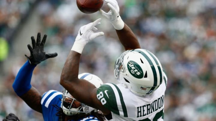 EAST RUTHERFORD, NJ - OCTOBER 14: Tight end Chris Herndon #89 of the New York Jets makes a catch against free safety Malik Hooker #29 of the Indianapolis Colts during the first quarter at MetLife Stadium on October 14, 2018 in East Rutherford, New Jersey. (Photo by Mike Stobe/Getty Images)
