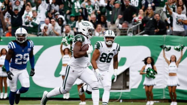 EAST RUTHERFORD, NJ - OCTOBER 14: Tight end Chris Herndon #89 of the New York Jets runs in for a touchdown against the Indianapolis Colts during the third quarter at MetLife Stadium on October 14, 2018 in East Rutherford, New Jersey. (Photo by Jeff Zelevansky/Getty Images)