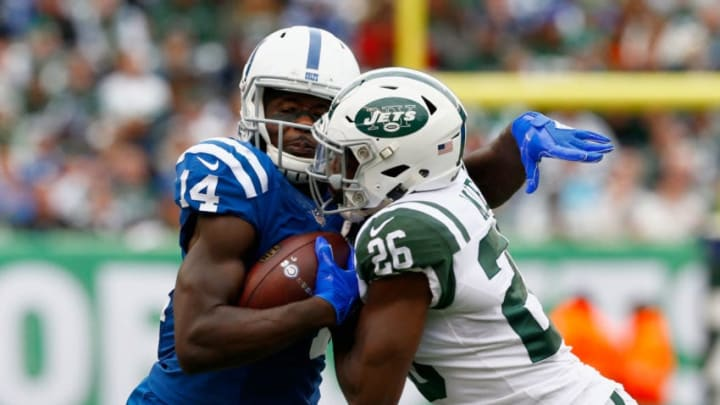 EAST RUTHERFORD, NJ - OCTOBER 14: Wide receiver Zach Pascal #14 of the Indianapolis Colts runs with the ball against free safety Marcus Maye #26 of the New York Jets during the third quarter at MetLife Stadium on October 14, 2018 in East Rutherford, New Jersey. (Photo by Mike Stobe/Getty Images)