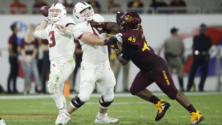 TEMPE, AZ - OCTOBER 18: Walker Little #72 of the Stanford Cardinal blocks for K.J. Costello #3 against George Lea #45 of the Arizona State Sun Devils in the third quarter of the game at Sun Devil Stadium on October 18, 2018 in Tempe, Arizona. Stanford won 20-13. (Photo by Joe Robbins/Getty Images)