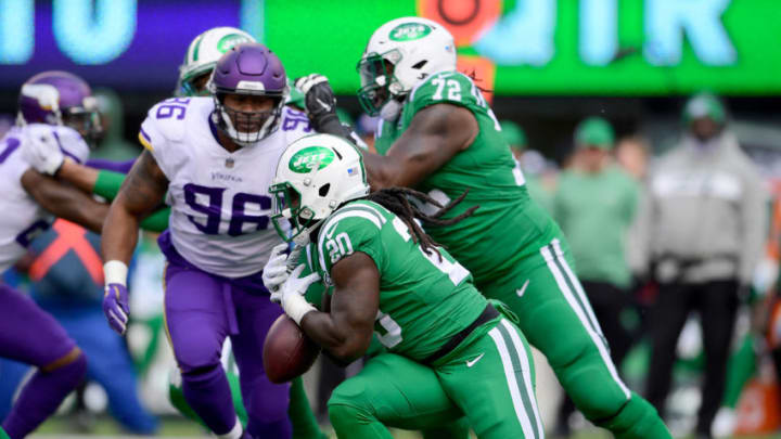 EAST RUTHERFORD, NJ - OCTOBER 21: Isaiah Crowell #20 of the New York Jets fumbles the ball on a run attempt against the Minnesota Vikings during the second quarter at MetLife Stadium on October 21, 2018 in East Rutherford, New Jersey. (Photo by Steven Ryan/Getty Images)