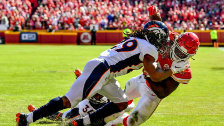 KANSAS CITY, MO – OCTOBER 28: Kareem Hunt #27 of the Kansas City Chiefs is tackled just short of the goal line by Bradley Roby #29 of the Denver Broncos during the second half of the game at Arrowhead Stadium on October 28, 2018 in Kansas City, Missouri. (Photo by Peter Aiken/Getty Images)