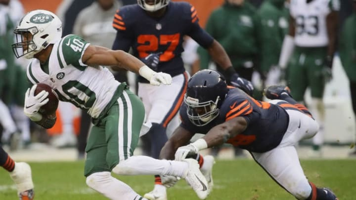 CHICAGO, IL - OCTOBER 28: Trenton Cannon #40 of the New York Jets escapes a tackle attempt by Roquan Smith #58 of the Chicago Bears at Soldier Field on October 28, 2018 in Chicago, Illinois. The Bears defeated the Jets 24-10. (Photo by Jonathan Daniel/Getty Images)