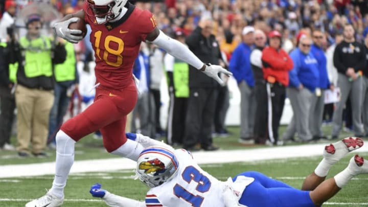 LAWRENCE, KS - NOVERMBER 3: Wide receiver Hakeem Butler #18 of the Iowa State Cyclones slips past cornerback Hasan Defense #13 of the Kansas Jayhawks as goes for a 51-yard touchdown pass in the first quarter at Memorial Stadium on November 3, 2018 in Lawrence, Kansas. (Photo by Ed Zurga/Getty Images)
