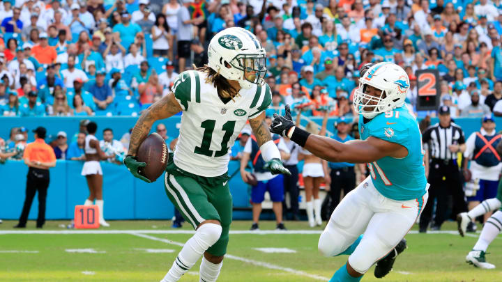 MIAMI, FL – NOVEMBER 04: Robby Anderson #11 of the New York Jets carries the ball against Jerome Baker #55 of the Miami Dolphins in the first quarter of their game at Hard Rock Stadium on November 4, 2018 in Miami, Florida. (Photo by Cliff Hawkins/Getty Images)
