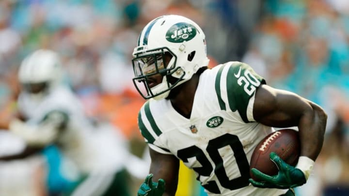 MIAMI, FL - NOVEMBER 04: Isaiah Crowell #20 of the New York Jets carries the ball against the Miami Dolphins in the first half of their game at Hard Rock Stadium on November 4, 2018 in Miami, Florida. (Photo by Michael Reaves/Getty Images)