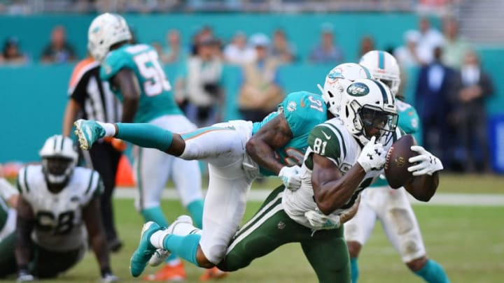 MIAMI, FL - NOVEMBER 04: Quincy Enunwa #81 of the New York Jets completes a reception against the defense of Cornell Armstrong #31 of the Miami Dolphins in the second half of their game at Hard Rock Stadium on November 4, 2018 in Miami, Florida. (Photo by Mark Brown/Getty Images)
