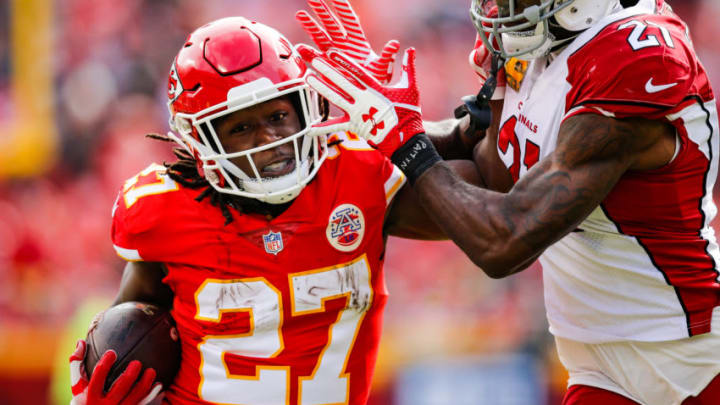 KANSAS CITY, MO - NOVEMBER 11: Kareem Hunt #27 of the Kansas City Chiefs tries to fight off a tackle from Patrick Peterson #21 of the Arizona Cardinals during the first half of the game at Arrowhead Stadium on November 11, 2018 in Kansas City, Missouri. (Photo by David Eulitt/Getty Images)