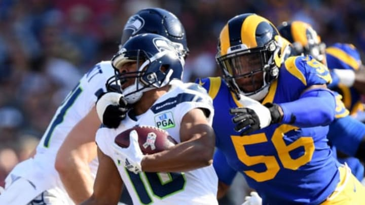 LOS ANGELES, CA – NOVEMBER 11: Tyler Lockett #16 of the Seattle Seahawks is grabbed by Dante Fowler #56 of the Los Angeles Rams during a 36-31 Rams win at Los Angeles Memorial Coliseum on November 11, 2018 in Los Angeles, California. (Photo by Harry How/Getty Images)