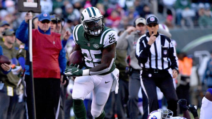 EAST RUTHERFORD, NEW JERSEY - NOVEMBER 11: Elijah McGuire #25 of the New York Jets carries the ball against the Buffalo Bills during the second quarter at MetLife Stadium on November 11, 2018 in East Rutherford, New Jersey. (Photo by Mark Brown/Getty Images)