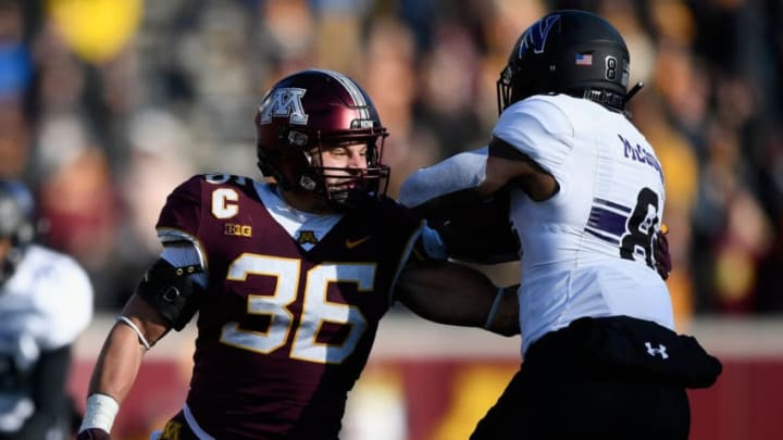 MINNEAPOLIS, MINNESOTA - NOVEMBER 17: Blake Cashman #36 of the Minnesota Golden Gophers tackles Kyric McGowan #8 of the Northwestern Wildcats during the fourth quarter of the game at TCFBank Stadium on November 17, 2018 in Minneapolis, Minnesota. Northwestern defeated Minnesota 24-14. (Photo by Hannah Foslien/Getty Images)