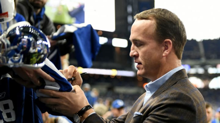 INDIANAPOLIS, INDIANA - NOVEMBER 18: Peyton Manning signs autographs before the game against the Tennessee Titans and Indianapolis Colts at Lucas Oil Stadium on November 18, 2018 in Indianapolis, Indiana. (Photo by Bobby Ellis/Getty Images)