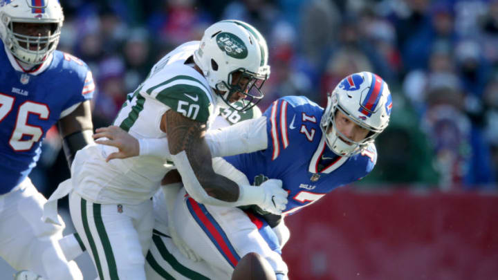 BUFFALO, NY - DECEMBER 09: Josh Allen #17 of the Buffalo Bills fumbles the ball in the first quarter during NFL game action as he is hit by Frankie Luvu #50 of the New York Jets at New Era Field on December 9, 2018 in Buffalo, New York. (Photo by Tom Szczerbowski/Getty Images)
