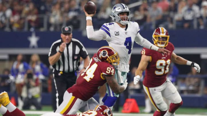ARLINGTON, TEXAS – NOVEMBER 22: Dak Prescott #4 of the Dallas Cowboys passes the ball as he is tackled by Preston Smith #94 and Stacy McGee #92 of the Washington Redskins in the second quarter at AT&T Stadium on November 22, 2018 in Arlington, Texas. (Photo by Richard Rodriguez/Getty Images)