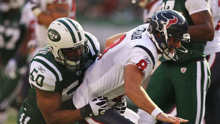 EAST RUTHERFORD, NJ – NOVEMBER 21: Vernon Gholston #50 of the New York Jets Tackles Matt Shaub #8 of the Houston Texans during their game on November21, 2010 at the New Meadowlands Stadium in East Rutherford, New Jersey. (Photo by Al Bello/Getty Images)