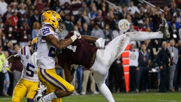 COLLEGE STATION, TEXAS - NOVEMBER 24: Quartney Davis #1 of the Texas A&M Aggies scores a touchdown in overtime as Greedy Williams #29 of the LSU Tigers is late on coverage at Kyle Field on November 24, 2018 in College Station, Texas. (Photo by Bob Levey/Getty Images)