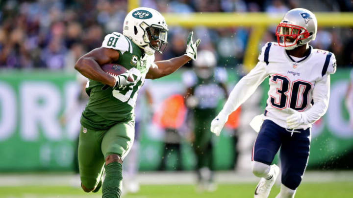 EAST RUTHERFORD, NEW JERSEY - NOVEMBER 25: Quincy Enunwa #81 of the New York Jets is pursued by Jason McCourty #30 of the New England Patriots during the first half at MetLife Stadium on November 25, 2018 in East Rutherford, New Jersey. (Photo by Sarah Stier/Getty Images)