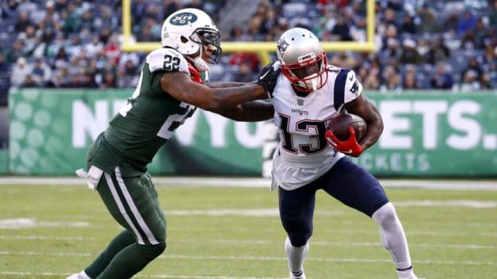 EAST RUTHERFORD, NEW JERSEY - NOVEMBER 25: Phillip Dorsett #13 of the New England Patriots is tackled by Trumaine Johnson #22 of the New York Jets during the fourth quarter at MetLife Stadium on November 25, 2018 in East Rutherford, New Jersey. (Photo by Jeff Zelevansky/Getty Images)