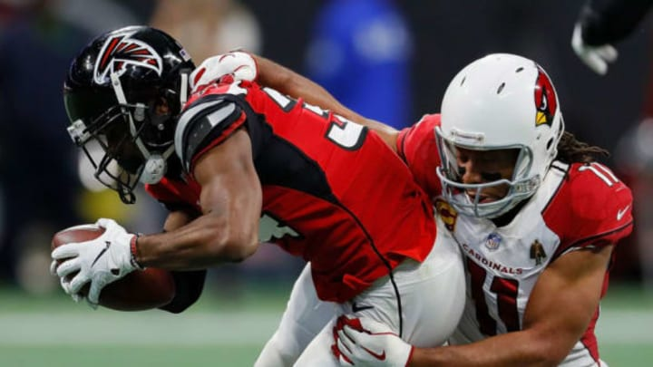 ATLANTA, GA – DECEMBER 16: Brian Poole #34 of the Atlanta Falcons is tackled by Larry Fitzgerald #11 of the Arizona Cardinals after an interception at Mercedes-Benz Stadium on December 16, 2018 in Atlanta, Georgia. (Photo by Kevin C. Cox/Getty Images)