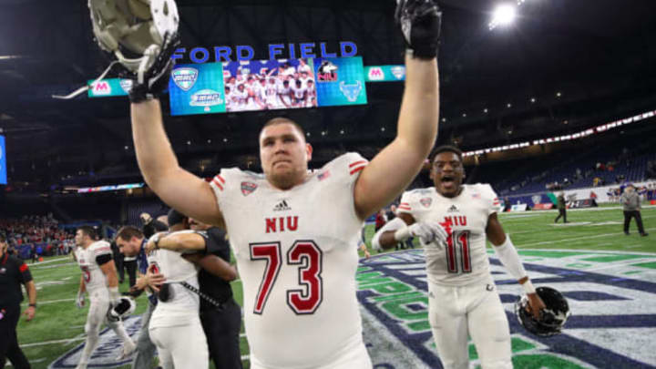 DETROIT, MICHIGAN – NOVEMBER 30: Max Scharping #73 of the Northern Illinois Huskies celebrates after defeating the Buffalo Bulls 30-29 to win the MAC Championship at Ford Field on November 30, 2018 in Detroit, Michigan. (Photo by Gregory Shamus/Getty Images)