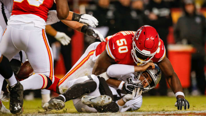 KANSAS CITY, MO - DECEMBER 30: Derek Carr #4 of the Oakland Raiders is sacked and stripped by Justin Houston #50 of the Kansas City Chiefs in the second half of the game at Arrowhead Stadium on December 30, 2018 in Kansas City, Missouri. (Photo by David Eulitt/Getty Images)