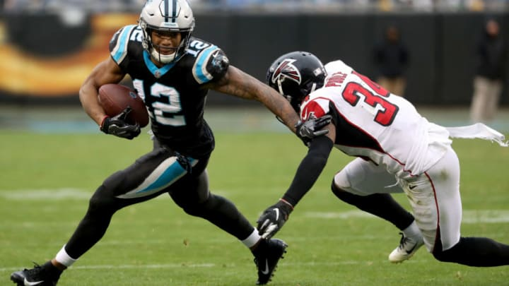 CHARLOTTE, NORTH CAROLINA - DECEMBER 23: Brian Poole #34 of the Atlanta Falcons tries to stop D.J. Moore #12 of the Carolina Panthers during their game at Bank of America Stadium on December 23, 2018 in Charlotte, North Carolina. (Photo by Streeter Lecka/Getty Images)