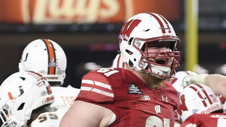 NEW YORK, NEW YORK - DECEMBER 27: Tyler Biadasz #61 of the Wisconsin Badgers reacts after the Badgers score a touchdown in the third quarter of the New Era Pinstripe Bowl against the Miami Hurricanes at Yankee Stadium on December 27, 2018 in the Bronx borough of New York City. (Photo by Sarah Stier/Getty Images)