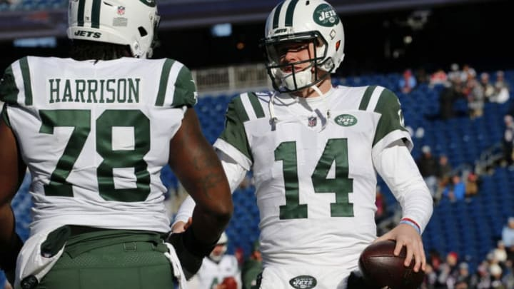 FOXBOROUGH, MASSACHUSETTS - DECEMBER 30: Sam Darnold #14 of the New York Jets talks with Jonotthan Harrison #78 before a game against the New England Patriots at Gillette Stadium on December 30, 2018 in Foxborough, Massachusetts. (Photo by Jim Rogash/Getty Images)