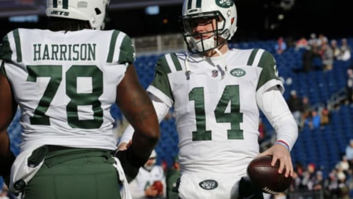 FOXBOROUGH, MASSACHUSETTS – DECEMBER 30: Sam Darnold #14 of the New York Jets talks with Jonotthan Harrison #78 before a game against the New England Patriots at Gillette Stadium on December 30, 2018 in Foxborough, Massachusetts. (Photo by Jim Rogash/Getty Images)