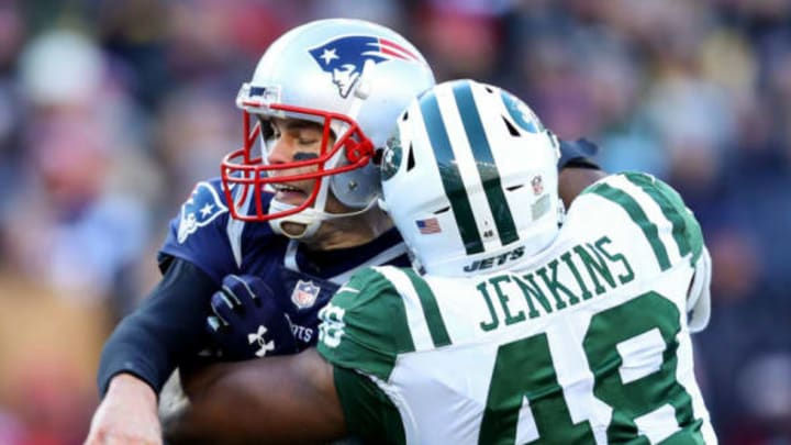 FOXBOROUGH, MASSACHUSETTS – DECEMBER 30: Tom Brady #12 of the New England Patriots is tackled by Jordan Jenkins #48 of the New York Jets during the second quarter of a game at Gillette Stadium on December 30, 2018 in Foxborough, Massachusetts. (Photo by Maddie Meyer/Getty Images)