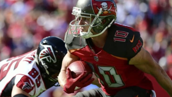 TAMPA, FLORIDA – DECEMBER 30: Adam Humphries #10 of the Tampa Bay Buccaneers looks for a path after receiving a punt during the second quarter against the Atlanta Falcons at Raymond James Stadium on December 30, 2018 in Tampa, Florida. New York Jets (Photo by Julio Aguilar/Getty Images)