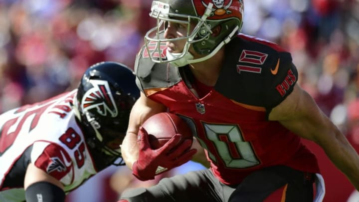 TAMPA, FLORIDA - DECEMBER 30: Adam Humphries #10 of the Tampa Bay Buccaneers looks for a path after receiving a punt during the second quarter against the Atlanta Falcons at Raymond James Stadium on December 30, 2018 in Tampa, Florida. (Photo by Julio Aguilar/Getty Images)