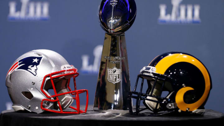 ATLANTA, GA - JANUARY 30: Detail of the Lombardi Trophy and the helmets of the New England Patriots (left) and the Los Angeles Rams prior to NFL Commissioner Roger Goodell speaking during a press conference during Super Bowl LIII Week at the NFL Media Center inside the Georgia World Congress Center on January 30, 2019 in Atlanta, Georgia. (Photo by Mike Zarrilli/Getty Images)