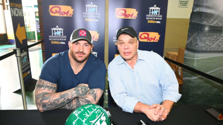 OCEANPORT, NJ - FEBRUARY 03: American football offensive guard for the New York Jets Brian Winters and former NFL player of New York Jets Joe Klecko sign autographs as Super Bowl Sunday at Monmouth Park Sports Book by William Hill on February 3, 2019 in Oceanport, New Jersey. (Photo by Dave Kotinsky/Getty Images for William Hill US)