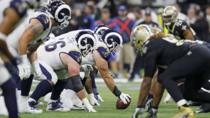 NEW ORLEANS, LOUISIANA – JANUARY 20: John Sullivan #65 of the Los Angeles Rams prepares to snap a ball against the New Orleans Saints during the second quarter in the NFC Championship game at the Mercedes-Benz Superdome on January 20, 2019 in New Orleans, Louisiana. (Photo by Kevin C. Cox/Getty Images)