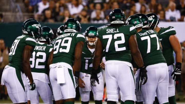 EAST RUTHERFORD, NJ - AUGUST 24: Sam Darnold #14 of the New York Jets leads a huddle during a pre-season game against the New Orleans Saints at MetLife Stadium on August 24, 2019 in East Rutherford, New Jersey. (Photo by Jeff Zelevansky/Getty Images)