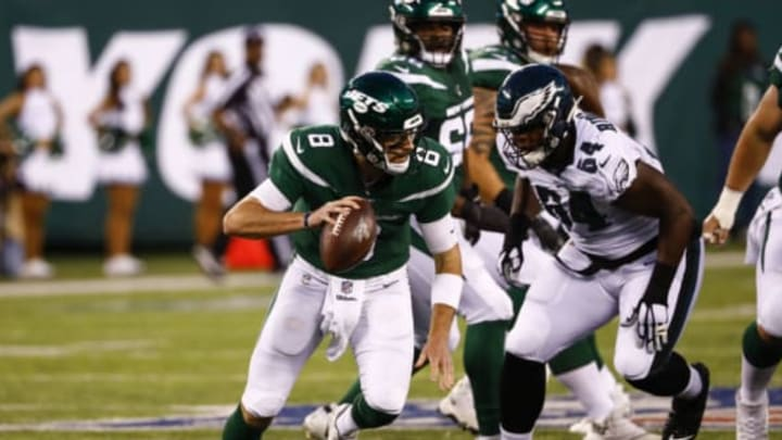 EAST RUTHERFORD, NJ – AUGUST 29: Luke Falk #8 of the New York Jets rolls out in front of Keegan Ridgeway #64 of Philadelphia Eagles during the preseason game at MetLife Stadium on August 29, 2019 in East Rutherford, New Jersey. New York Jets (Photo by Jeff Zelevansky/Getty Images)