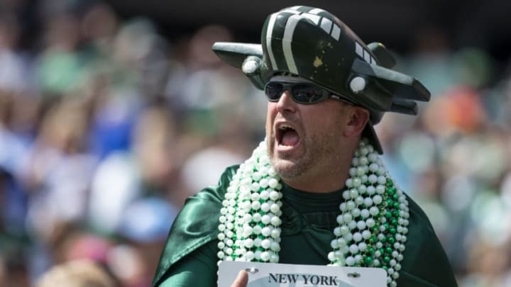 EAST RUTHERFORD, NJ - SEPTEMBER 08: A New York Jets fan cheers before the game against the Buffalo Bills at MetLife Stadium on September 8, 2019 in East Rutherford, New Jersey. (Photo by Brett Carlsen/Getty Images)
