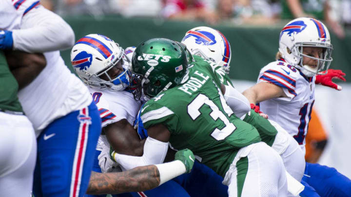 EAST RUTHERFORD, NJ - SEPTEMBER 08: Brian Poole #34 of the New York Jets stops Frank Gore #20 of the Buffalo Bills for a safety during the third quarter at MetLife Stadium on September 8, 2019 in East Rutherford, New Jersey. Buffalo defeats New York 17-16. (Photo by Brett Carlsen/Getty Images)